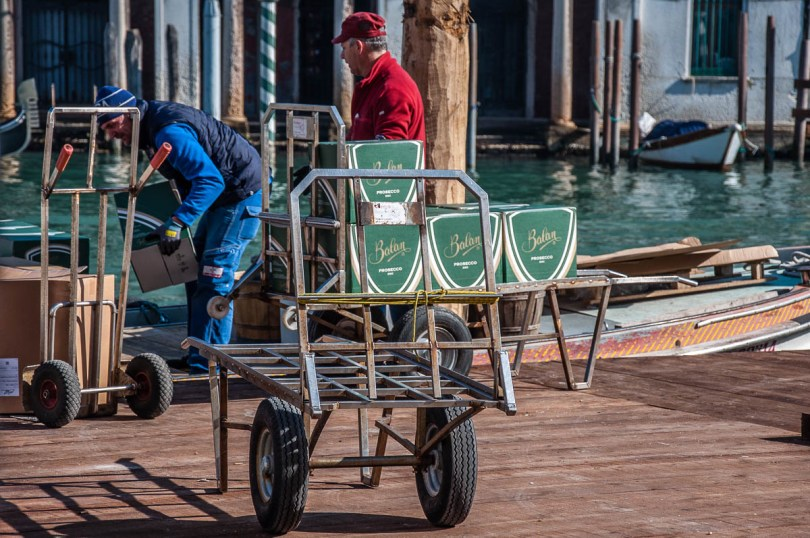 Unloading boxes with prosecco off a boat - Venice, Veneto, Italy - www.rossiwrites.com