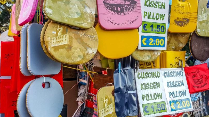 A stall selling souvenir cushions - Verona Opera Festival - Veneto, Italy - www.rossiwrites.com