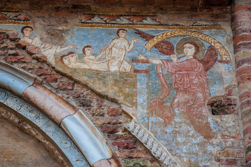 A faded fresco of the Last Judgement above the entrance of the Church of Santi Felice e Fortunato - Vicenza, Italy - www.rossiwrites.com