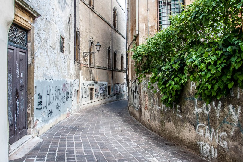 Curved street covered with grafitti - Vicenza, Italy - www.rossiwrites.com