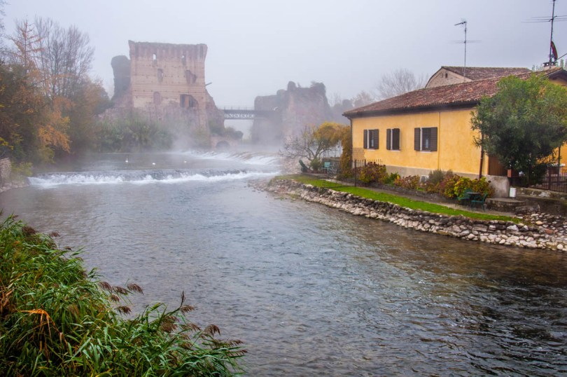 The Visconti bridge with the river Mincio and a yellow house - Borghetto sul Mincio, Veneto, Italy - www.rossiwrites.com