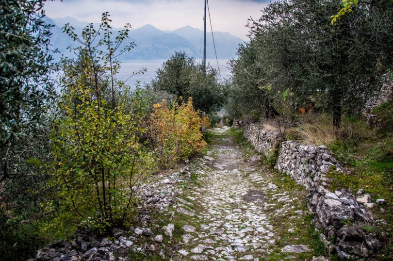 The stone-paved mule tracks with Lake Garda at the back - Campo di Brenzone, Lake Garda, Italy - www.rossiwrites.com