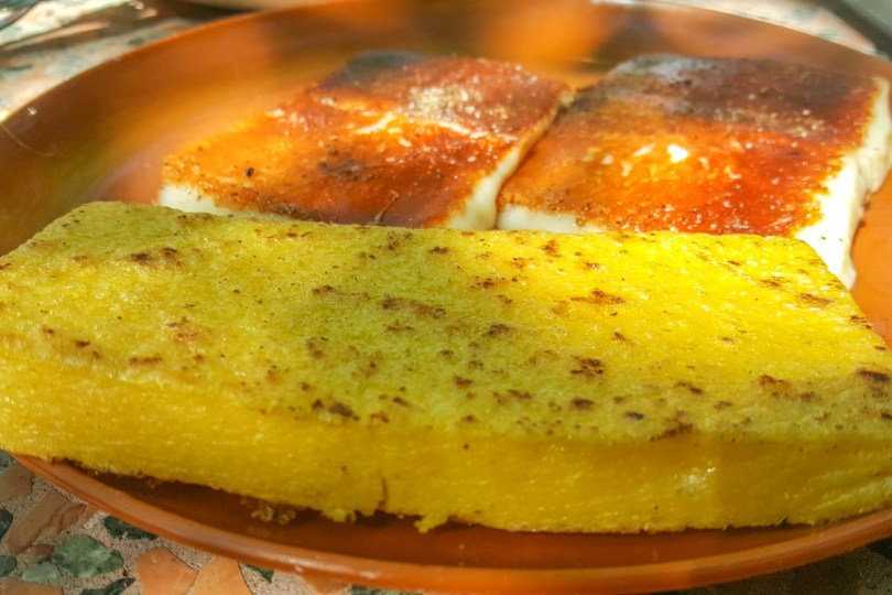 A slice of grilled polenta with grilled cheese - Osteria ai Pioppi, Veneto, Italy - www.rossiwrites.com