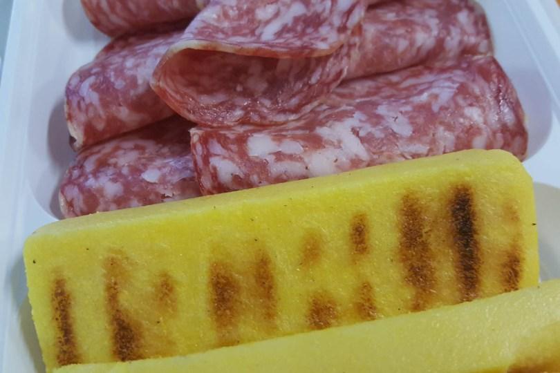 Polenta served with soppressa salami - Valli del Pasubio, Veneto, Italy - www.rossiwrites.com