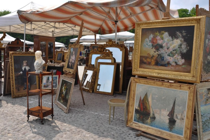 Stall with paintings at the antiques market in Piazzola sul Brenta, Veneto, Italy