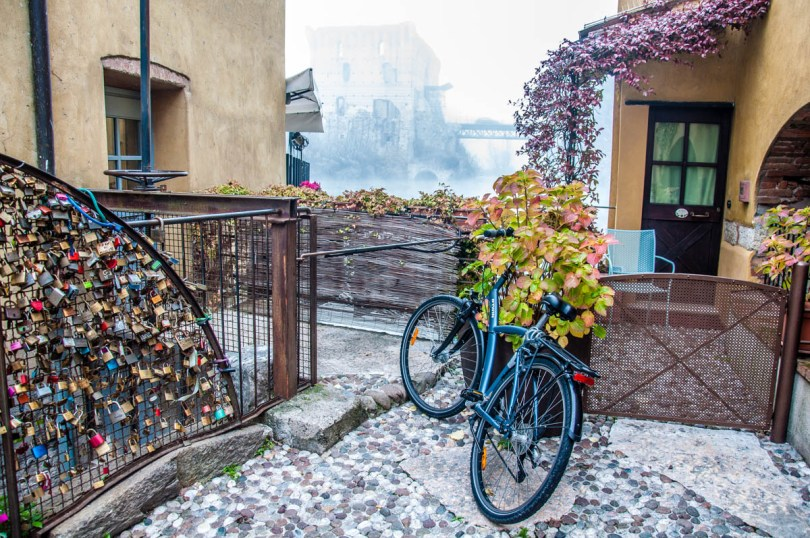 A bike, the old mills and the Visconti Bridge at the back - Borghetto sul Mincio, Italy - www.rossiwrites.com