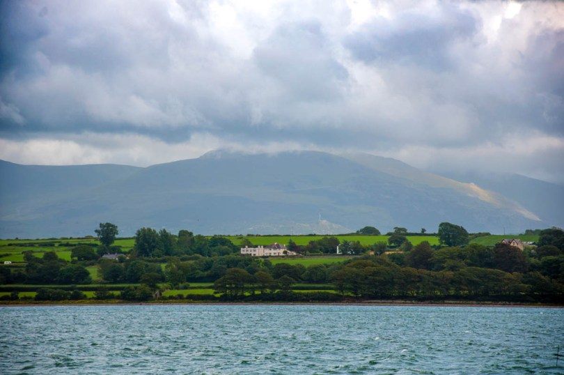 Snowdonia seen from the Menai Strait - Wales, UK - rossiwrites.com