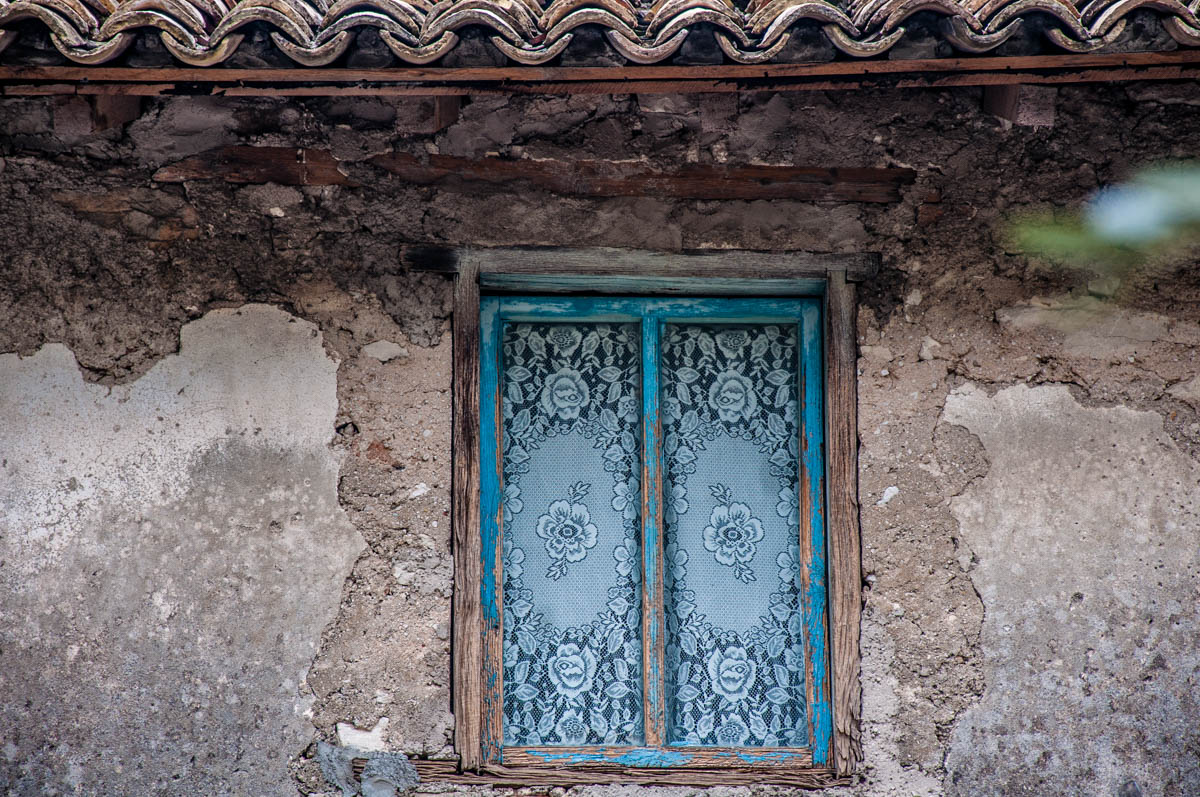 A window with a lacy curtain - Campo di Brenzone, Lake Garda, Veneto, Italy - rossiwrites.com