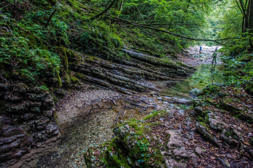 Walking on the river bed - Grotta Azzurra di Mel - Hiking in the Dolomites - Veneto, Italy - rossiwrites.com