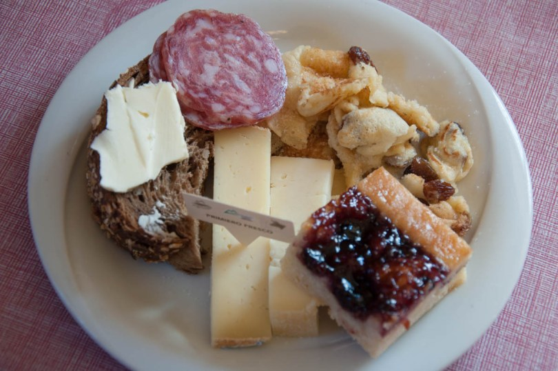 Traditional breakfast food served in Agritur Malga Rolle - Dolomites, Trentino, Italy - rossiwrites.com