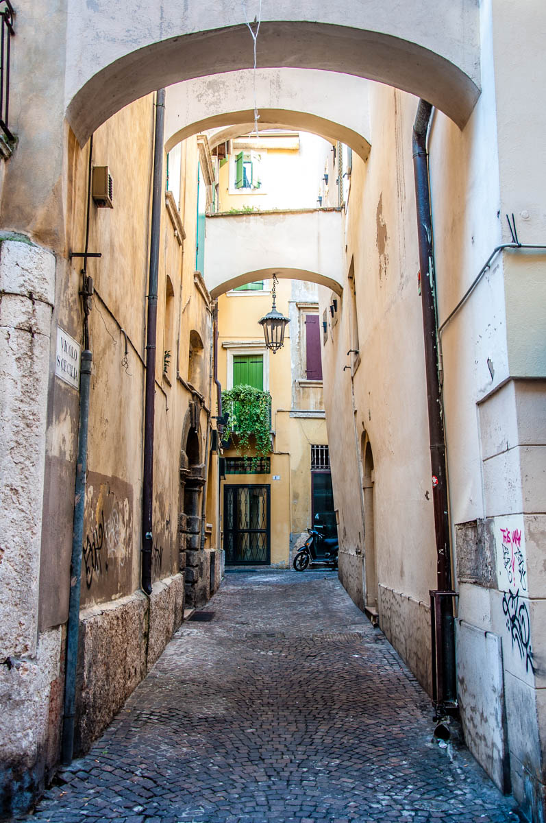 Side street with arches and a motorbike - Verona, Veneto, Italy - rossiwrites.com