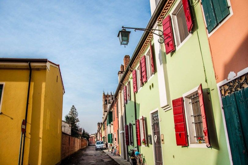 A row of colourful houses by the medieval wall - Montagnana, Veneto, Italy - rossiwrites.com