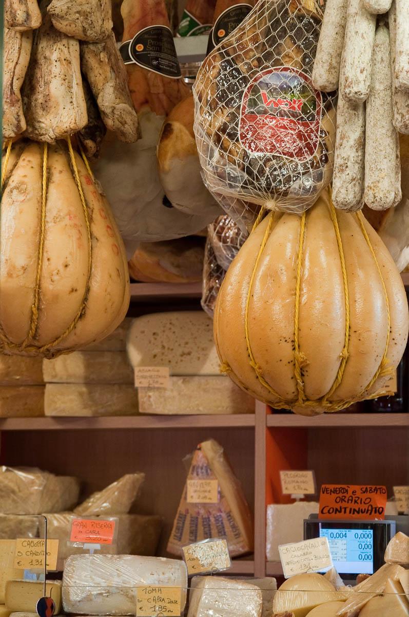 Cheeses and salumi in a shop on the ground floor of Palazzo della Raggione, Piazza delle Erbe, Padua, Italy - www.rossiwrites.com