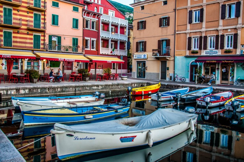 Colourful boats in the small harbour - Castelletto sul Garda, Veneto, Italy - rossiwrites.com