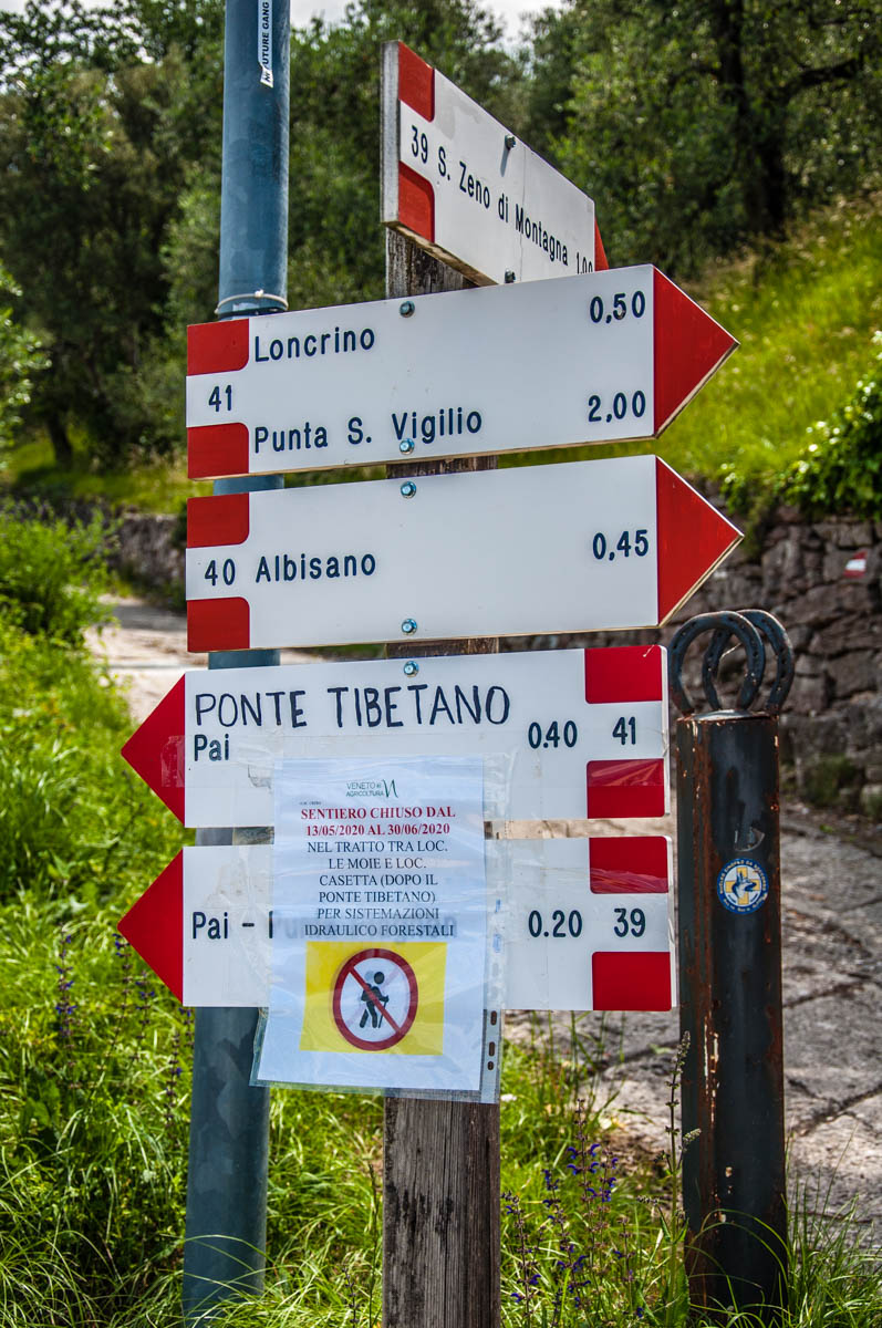 Signs pointing the way to different local hikes and walks - Crero, Lake Garda, Veneto, Italy - rossiwrites.com
