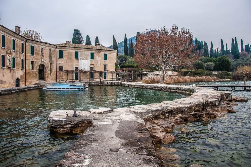 Locanda di San Vigilio with the small harbour - Punta di San Vigilio - Lake Garda, Italy - rossiwrites.com