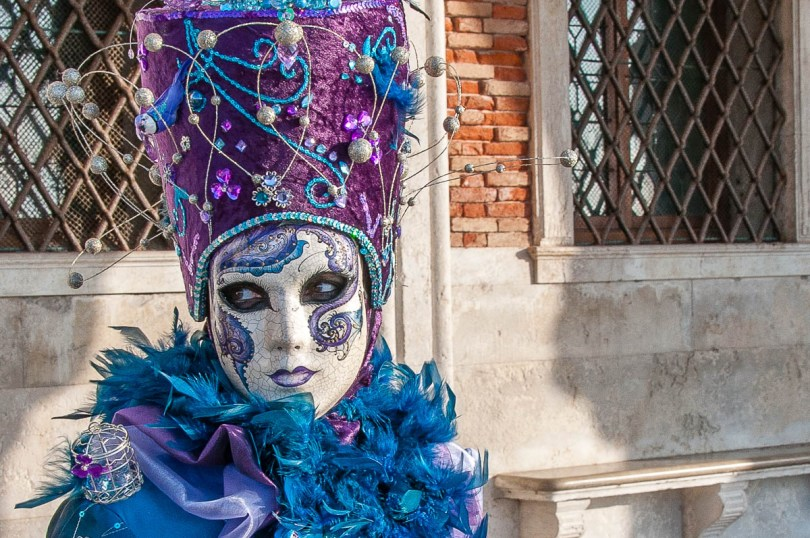 A beautiful mask in front of the Doge's Palace - Venice, Italy - rossiwrites.com