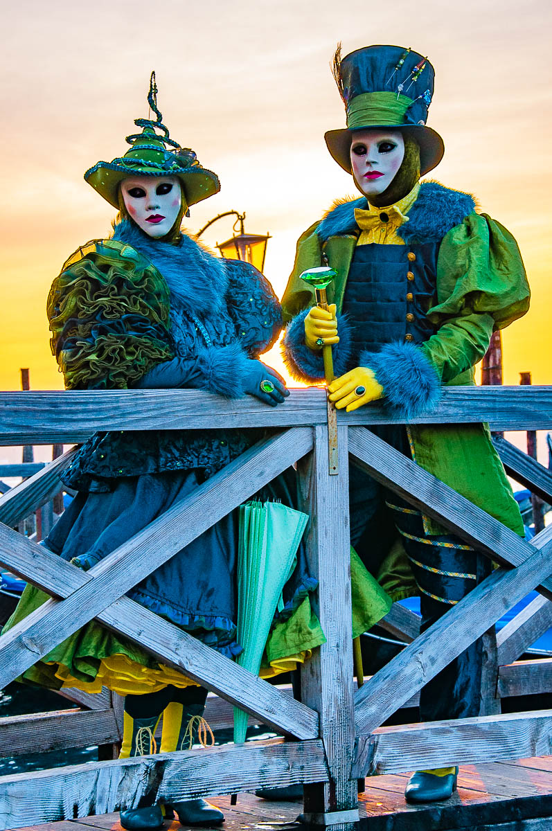 A female and male matching masks standing in front of the St. Mark's Basin - Venice, Italy - rossiwrites.com