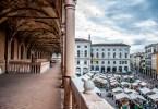 Piazza delle Erbe and the daily market seen from the loggia of Palazzo della Ragione - Padua, Veneto, Italy - rossiwrites.com