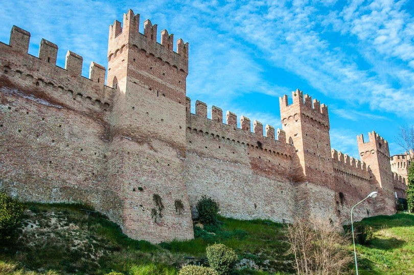 The mighty defensive wall surrounding the hilltop village - Gradara, Italy - rossiwrites.com