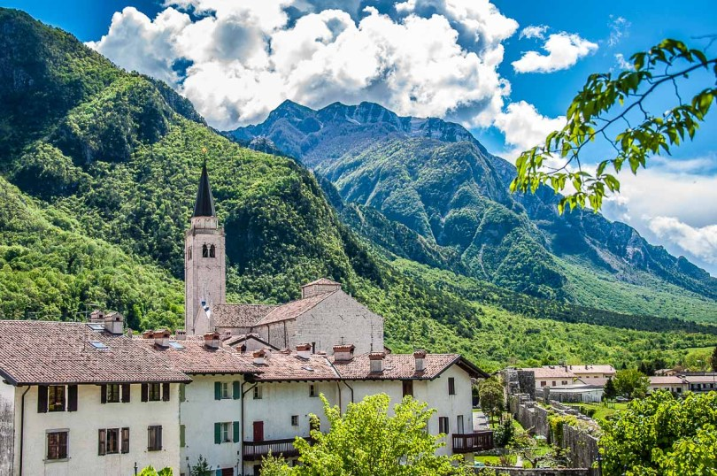 The village's bell tower with old houses around it - Venzone, Italy - rossiwrites.com