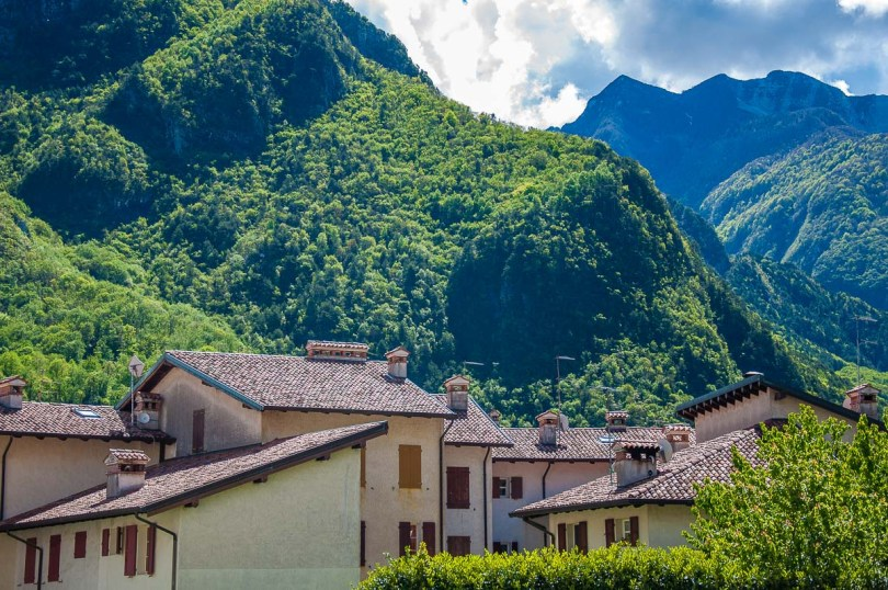 The village's houses against the lush mountains - Venzone, Italy - rossiwrites.com
