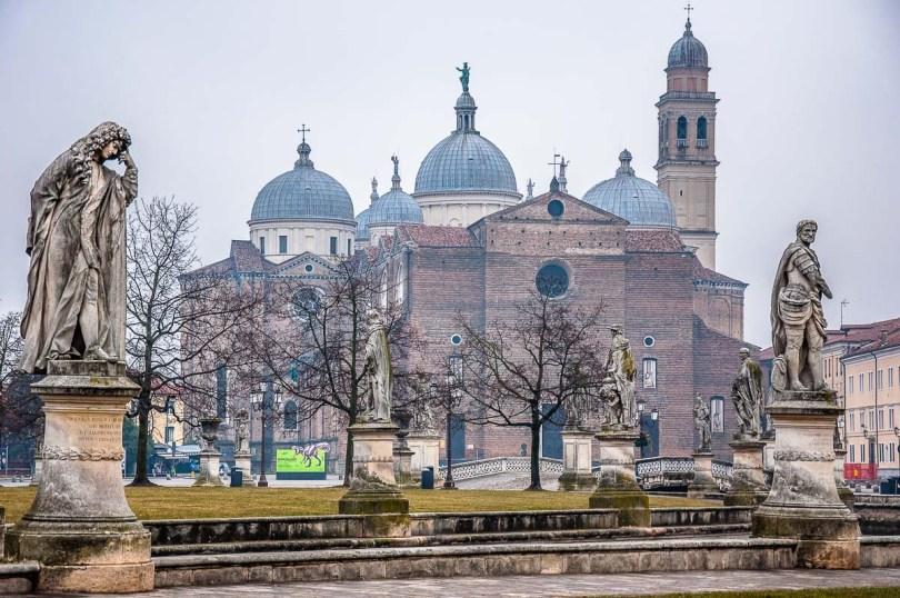 Statues on Prato della Valle with the Basilica of Santa Giustina - Padua, Italy - rossiwrites.com