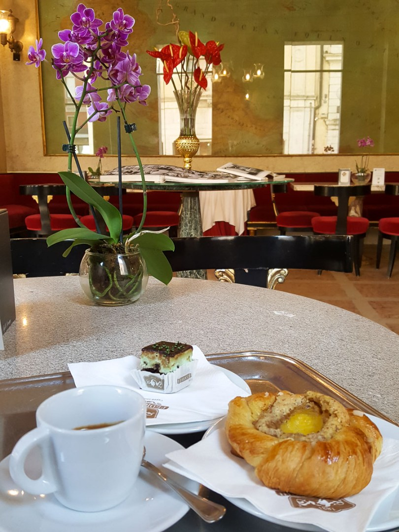 Typical Italian breakfast of coffee and pastry served in Caffe Pedrocchi - Padua, Italy - rossiwrites.com