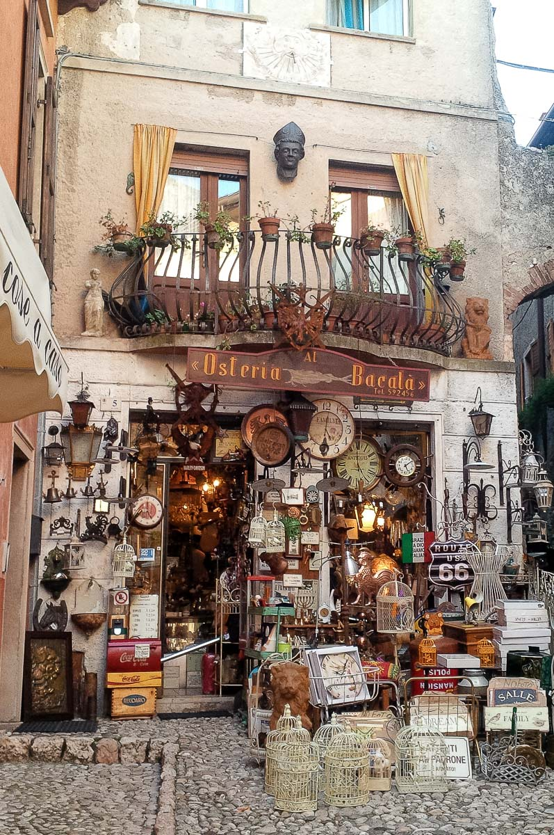 A bric-a-brac shop in the historic centre - Malcesine, Italy - rossiwrites.com