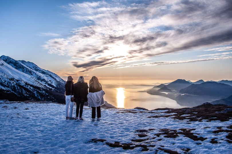 Sunset over Lake Garda seen from the snow-capped Monte Baldo in winter - Malcesine, Italy - rossiwrites.com