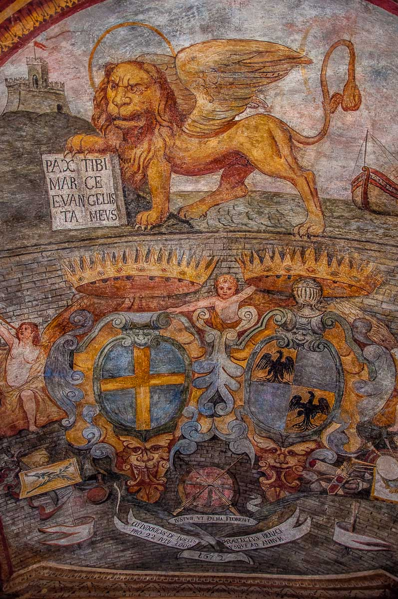 The fresco on the ceiling of the ground floor hall of Palazzo dei Capitani - Malcesine, Italy - rossiwrites.com