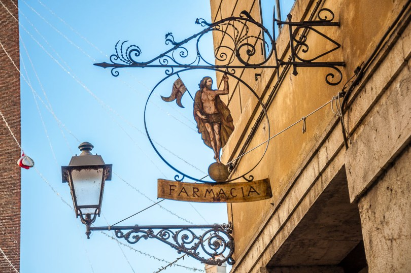 The sign of a historic pharmacy in Vicenza, Italy - rossiwrites.com