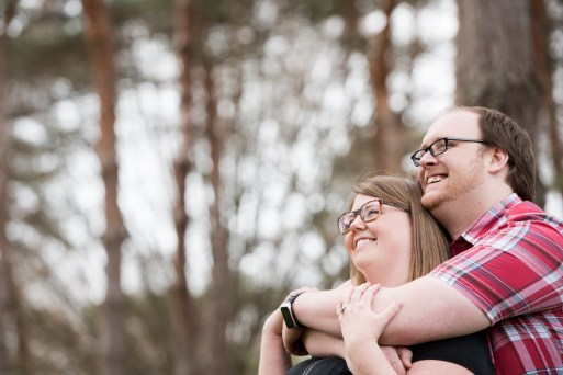 couple hugging engagement photos