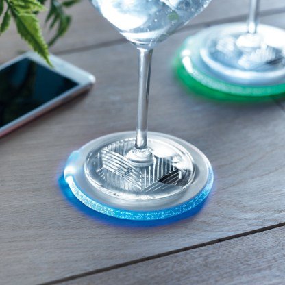 Light up coaster with opener