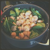 Shrimp and spinach in the pot.