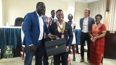 Handing over IPP Amos to President Roger