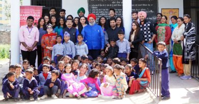 Rotaractors with children at the adopted school.