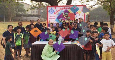 Rotarians and Rotaractors celebrate the Kite Festival with children.