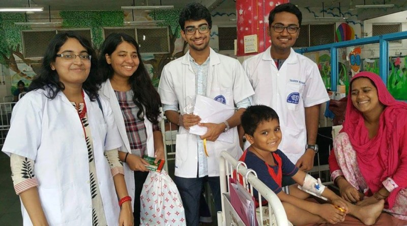 Rotaractors cheer up a child in a hospital under their Mitra project.