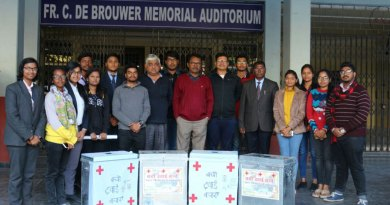 Rotaractors with the medicines collection boxes.