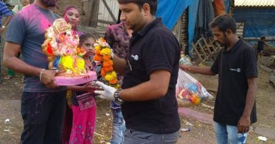 Rotaractors collect flowers and accessories adorning the Ganesh idols before the Visarjan.