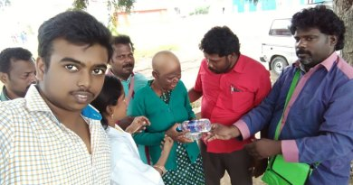 Rotaractors give food and water to a destitute woman.