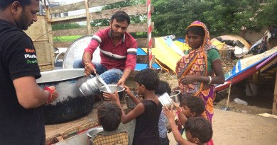Rotaractors distribute milk collected from temples to the needy.