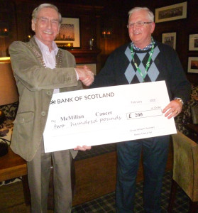 """Dennis Clifford from McMillan Cancer receiving a """"Treasure Chest"""" cheque for £200"""