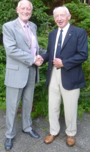 New President Douglas Haddow receives the chain of office from outgoing President Neil Beattie
