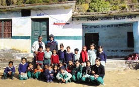 PRIP Kalyan Banerjee (Top right) and PRID Yash Pal Das along with the children in one of the older schools.
