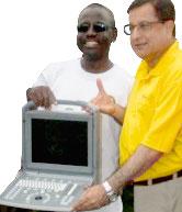 Rtn Dr Raju Sahetya with ultrasound machine.