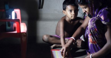 Solar lamp helps him to study at night.