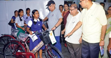 Bicycles being given to girl students.