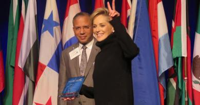 Actress and humanitarian Sharon Stone gives the peace sign after speaking at the Rotary World Peace Conference on 15 January in Ontario, California, USA.